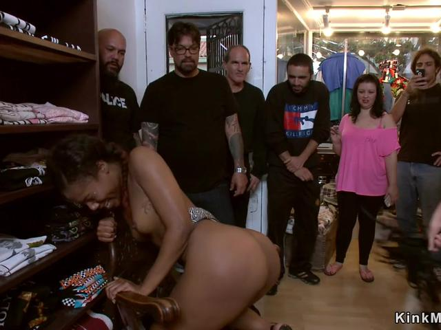Ebony spanked and fucked in public shop