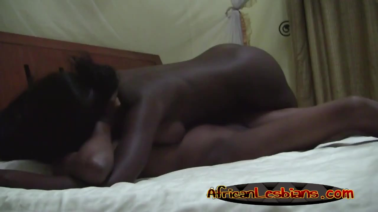 Ebony lesbians stroke clits and make out in bedroom