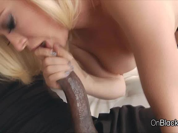 Sultry blonde sucks on big black cock