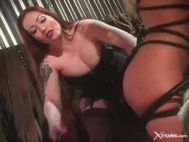 Horny dominatrix loves using a cat o nine tails...