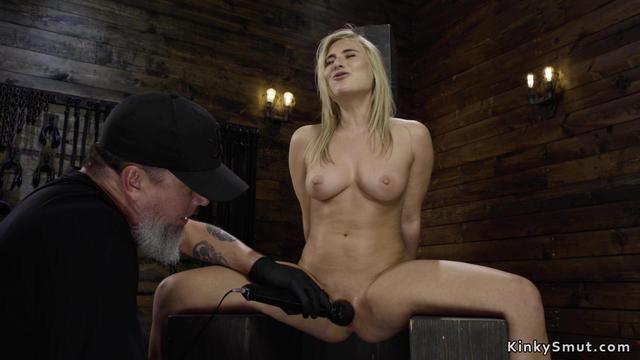 Busty blonde slave in bondage throne