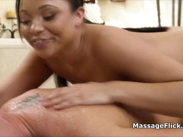 Ebony masseuse blows nervous client during massage