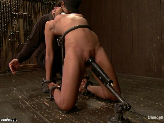 Ebony in pile driver shackled and toyed