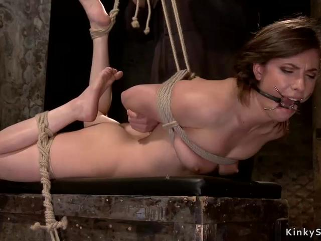 Gagged sub is pussy vibed on hogtie
