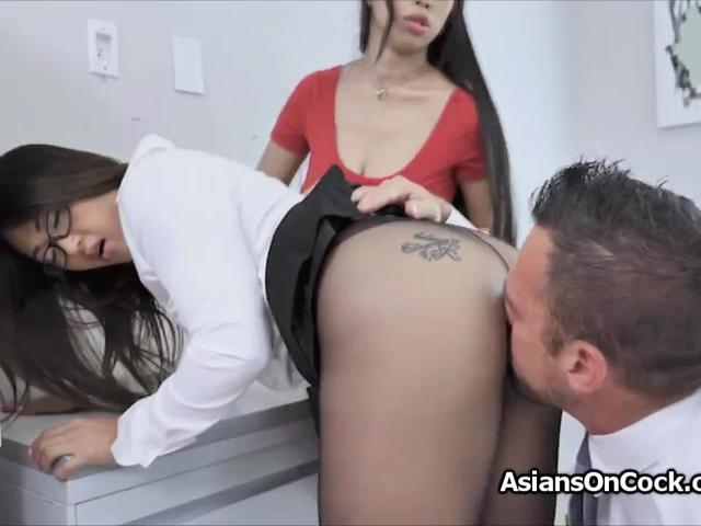 Banging two Asian secretaries at the office