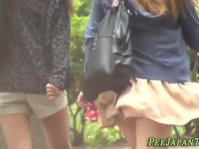 Asian boss lady urinates herself