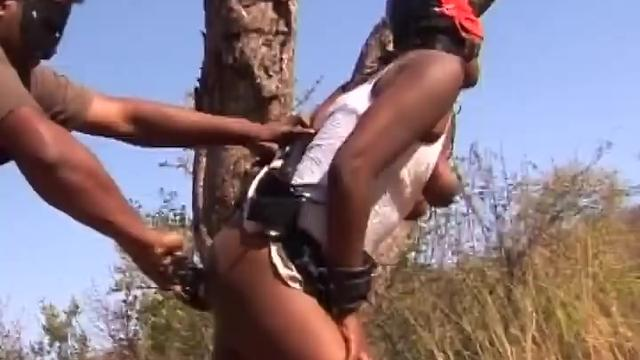 Kinky African broad gets tied up to a tree and properly spanked