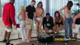Hot blondie gets the attention of new swingers after arriving at the Swinger Mansion and get horny.