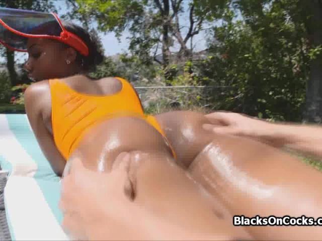 Sunny day with big black oiled booty