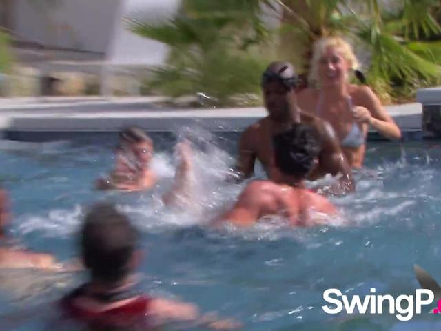 Swingers heat things up once they unite by the swimming pool