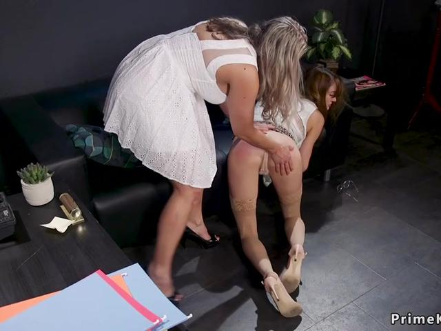 Busty Milf spanks stepdaughter in office