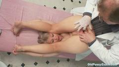 This mature lady gets her cunt checked up by a ...