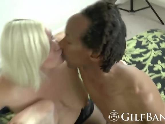 Mature woman and her stepdaughter are sharing a long, rock hard black cock