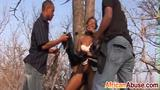 African slave tortured and pounded outdoors
