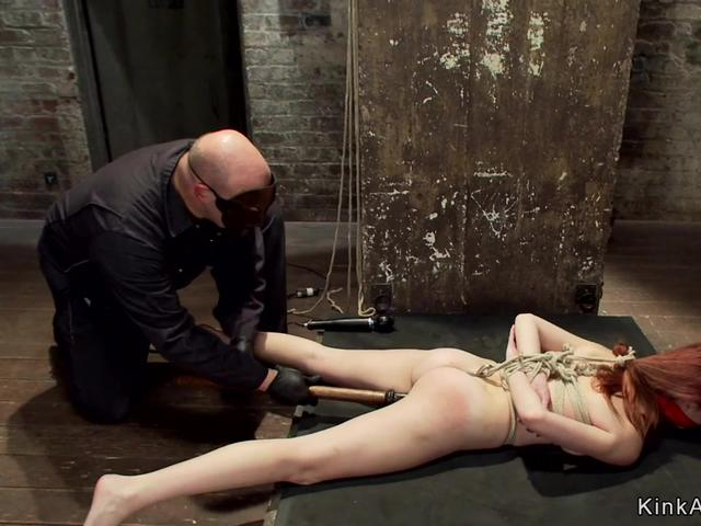 Redhead slave gets ass hooked on hogtie