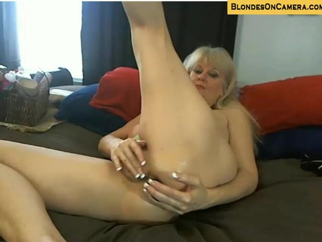 Blonde mature goes all crazy in all holes on cam