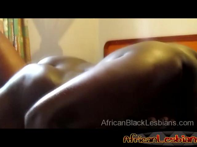 Hot ebony lesbians in a sexy black lingerie rub their vaginas on a bed