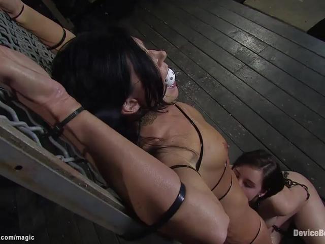 Bound slaves toyed in dark dungeon