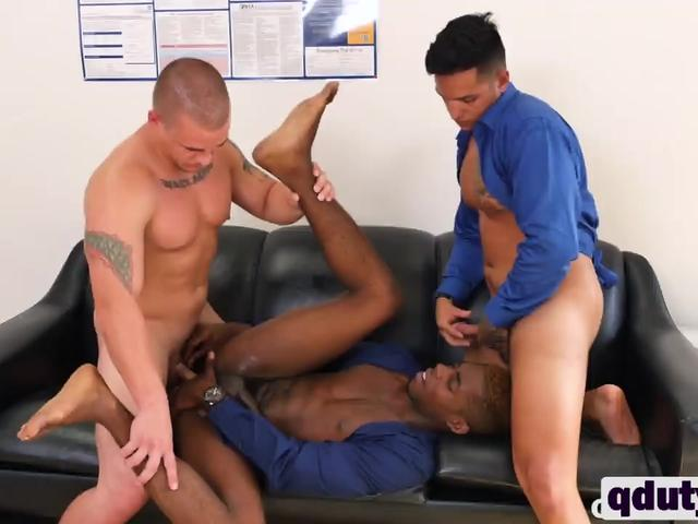Three gay studs having hot threesome in office