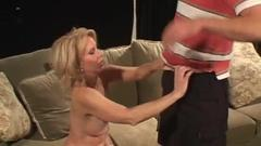 Enjoy this horny blonde milf tongues this juicy boner. She ...